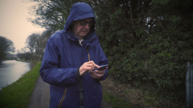 Michael uses an app on his mobile to track his walks